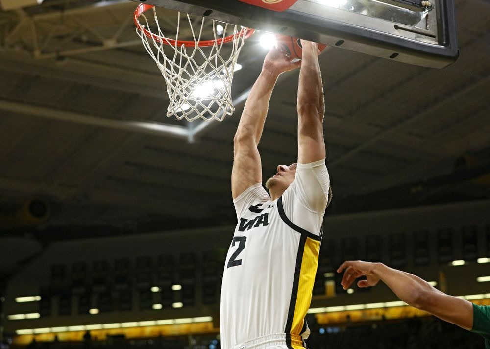 Iowa Hawkeyes forward Jack Nunge (2) dunks the ball during the first half of their game at Carver-Hawkeye Arena in Iowa City on Sunday, Nov 24, 2019. (Stephen Mally/hawkeyesports.com)