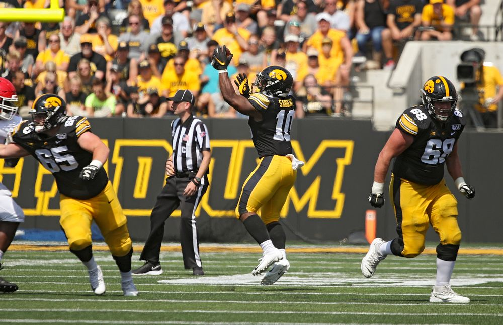Iowa Hawkeyes running back Mekhi Sargent (10) pulls in a pass with one hand during the third quarter of their Big Ten Conference football game at Kinnick Stadium in Iowa City on Saturday, Sep 7, 2019. (Stephen Mally/hawkeyesports.com)
