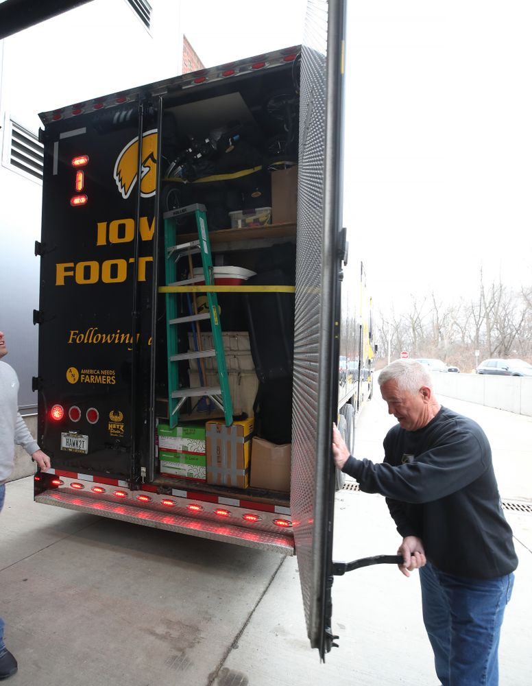 TanTara Transportation Corporation President Mike Riggan  locks up the trailer before departing for Tampa, Florida Friday, December 21, 2018 at the Hansen Football Performance Center. (Brian Ray/hawkeyesports.com)