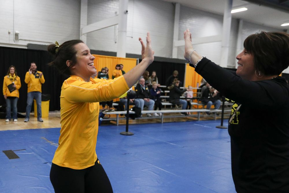 Gina Leal high fives assistant coach Jennifer Green before the Iowa women's gymnastics Black and Gold Intraquad Meet on Saturday, December 7, 2019 at the UI Field House. (Lily Smith/hawkeyesports.com)