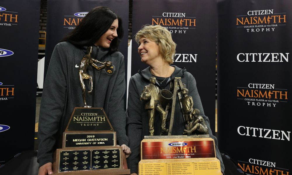 Iowa Hawkeyes forward Megan Gustafson (10)  with the Naismith Player Of The Year Trophy and head coach Lisa Bluder with the Naismith Coach Of the Year Trophy during the teamÕs Celebr-Eight event Wednesday, April 24, 2019 at Carver-Hawkeye Arena. (Brian Ray/hawkeyesports.com)
