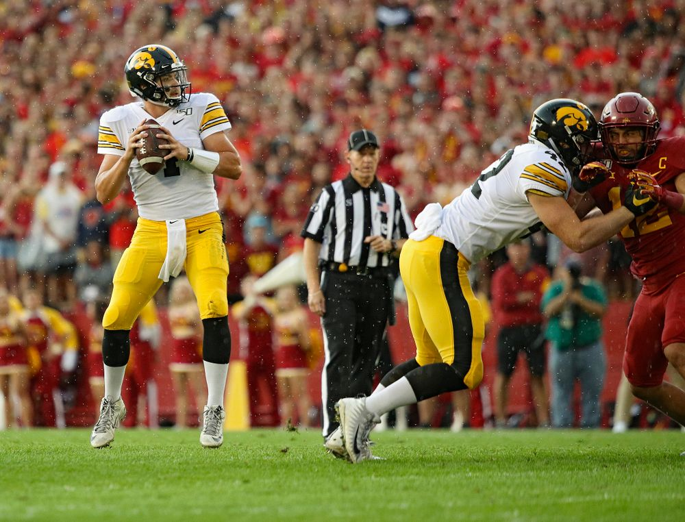 Iowa Hawkeyes quarterback Nate Stanley (4) looks to throw as tight end Shaun Beyer (42) blocks during the first quarter of their Iowa Corn Cy-Hawk Series game at Jack Trice Stadium in Ames on Saturday, Sep 14, 2019. (Stephen Mally/hawkeyesports.com)