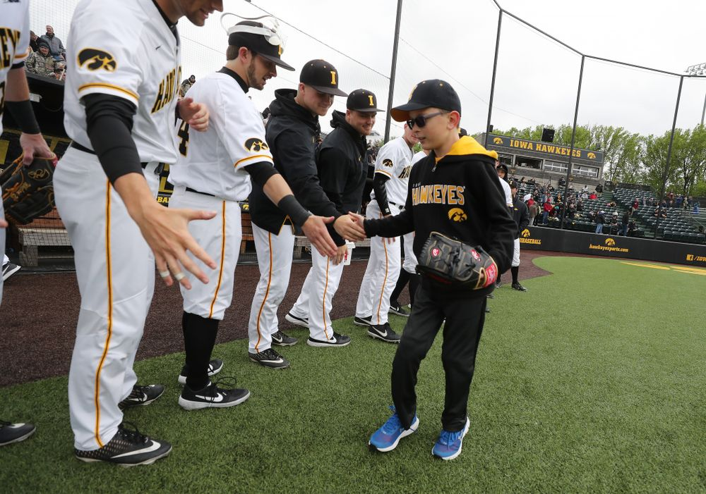 Garret Nichols throws out a first pitch before the Iowa Hawkeyes game against Michigan State Sunday, May 12, 2019 at Duane Banks Field. (Brian Ray/hawkeyesports.com)