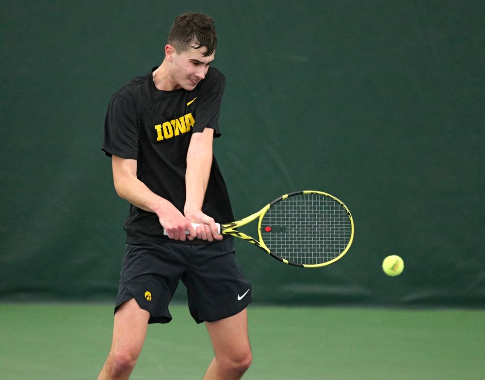 Iowa's Matt Clegg hits a shot during their doubles match against Marquette at the Hawkeye Tennis and Recreation Complex in Iowa City on Saturday, January 25, 2020. (Stephen Mally/hawkeyesports.com)