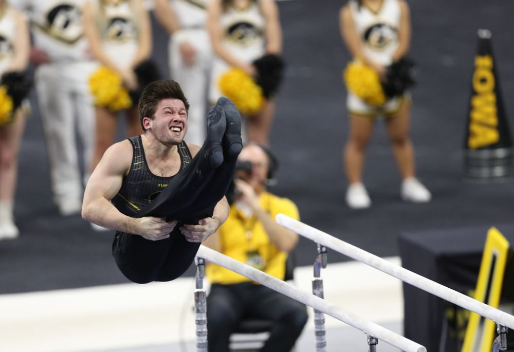Iowa's Rogelio Vazquez competes on the parallel bars against Oklahoma Saturday, February 9, 2019 at Carver-Hawkeye Arena. (Brian Ray/hawkeyesports.com)