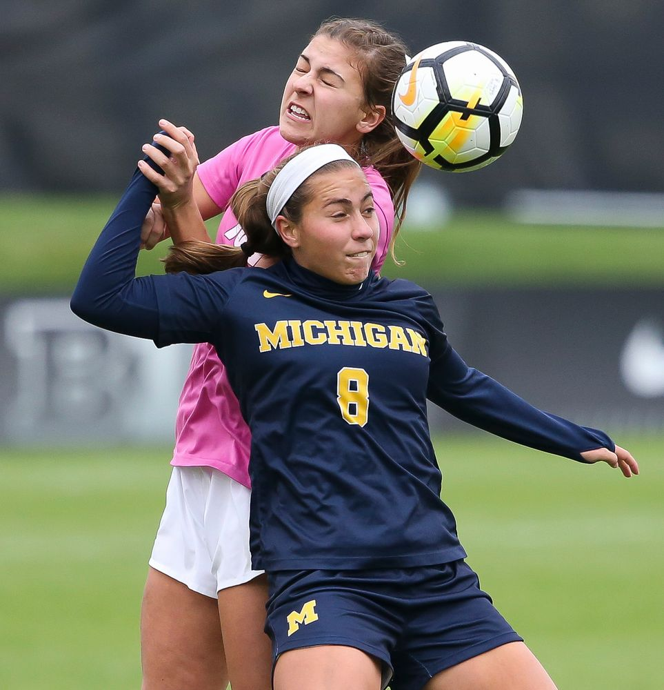 Iowa Hawkeyes defender Hannah Drkulec (17) heads the ball during a game against Michigan at the Iowa Soccer Complex on October 14, 2018. (Tork Mason/hawkeyesports.com)