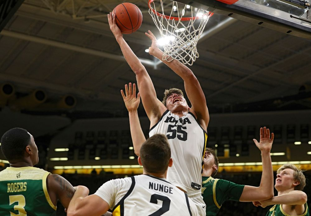 Iowa Hawkeyes center Luka Garza (55) scores a basket as forward Jack Nunge (2) looks on during the first half of their game at Carver-Hawkeye Arena in Iowa City on Sunday, Nov 24, 2019. (Stephen Mally/hawkeyesports.com)