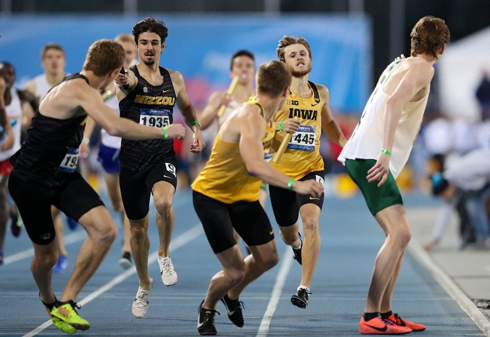 Iowa's Tysen VanDraska prepares to hand off the baton to Alec Still runs the men's 3200 meter relay event during the second day of the Drake Relays at Drake Stadium in Des Moines on Friday, Apr. 26, 2019. (Stephen Mally/hawkeyesports.com)