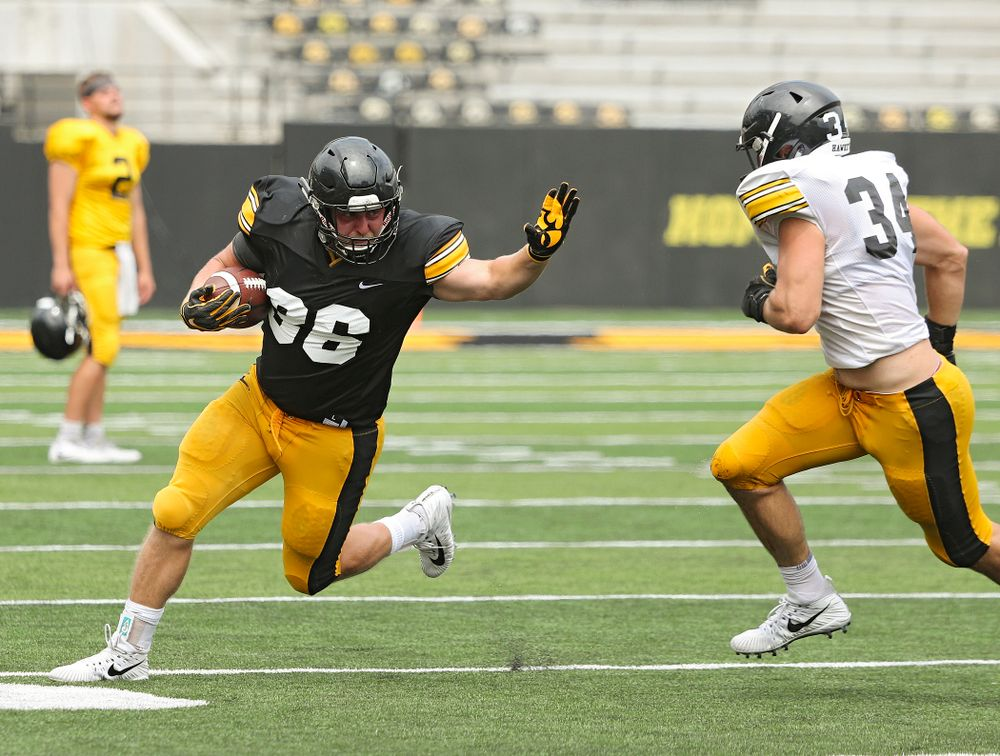 Iowa Hawkeyes fullback Brady Ross (36) tries to hold off linebacker Kristian Welch (34) during Fall Camp Practice No. 8 at Kids Day at Kinnick Stadium in Iowa City on Saturday, Aug 10, 2019. (Stephen Mally/hawkeyesports.com)
