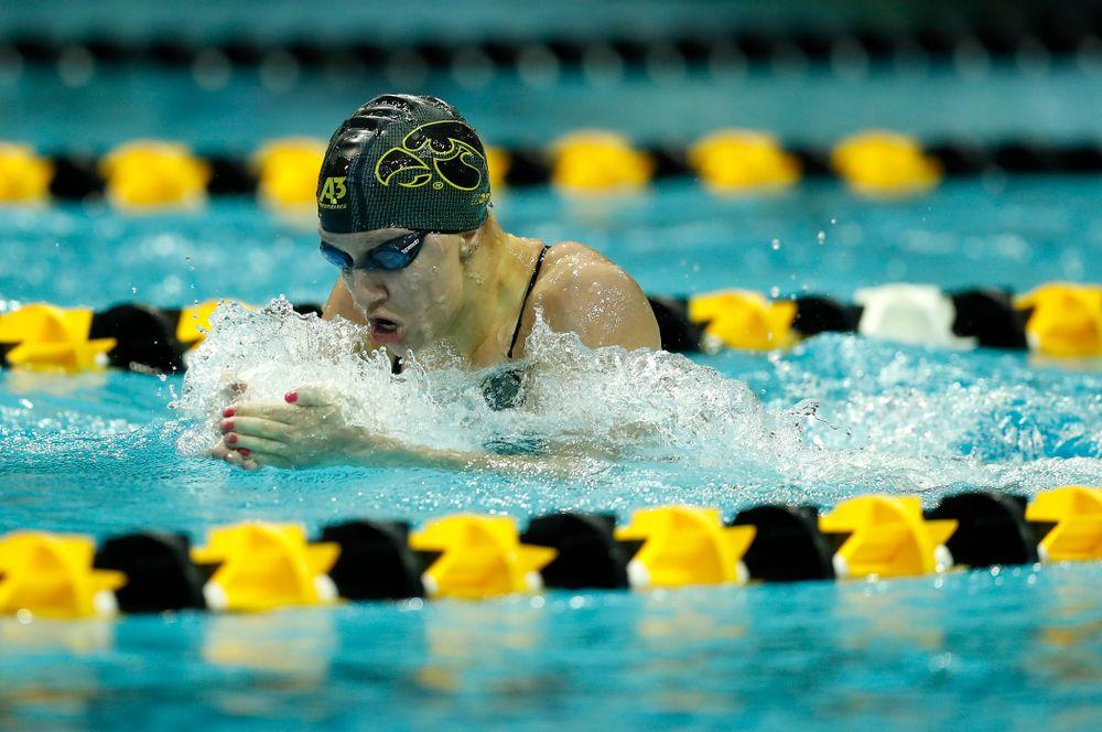 Iowa's Sage Ohlensehlen swims the 100 yard breaststroke