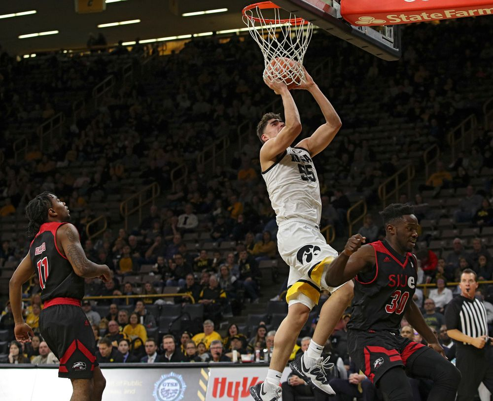 Iowa Hawkeyes center Luka Garza (55) scores a basket during the second half of their game at Carver-Hawkeye Arena in Iowa City on Friday, Nov 8, 2019. (Stephen Mally/hawkeyesports.com)