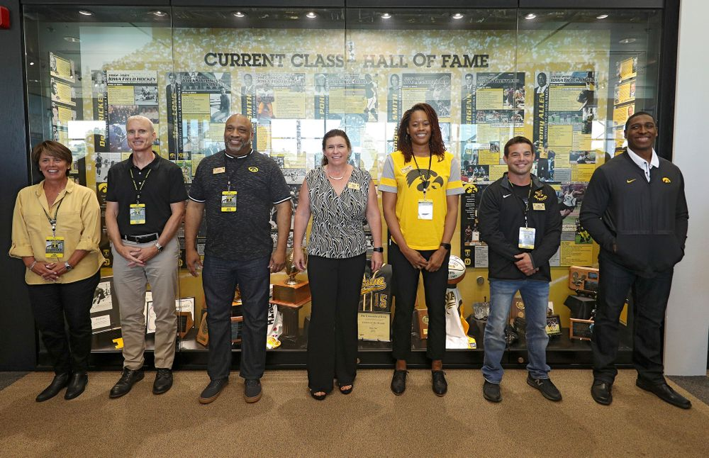2019 University of Iowa Athletics Hall of Fame inductee Deb Brickey, Marc Long, Leroy Smith, Diane Pohl, Tangela Smith, Eric Juergens, and Jeremy Allen stand in front of their exhibit after it was unveiled at the University of Iowa Athletics Hall of Fame in Iowa City on Friday, Aug 30, 2019. (Stephen Mally/hawkeyesports.com)