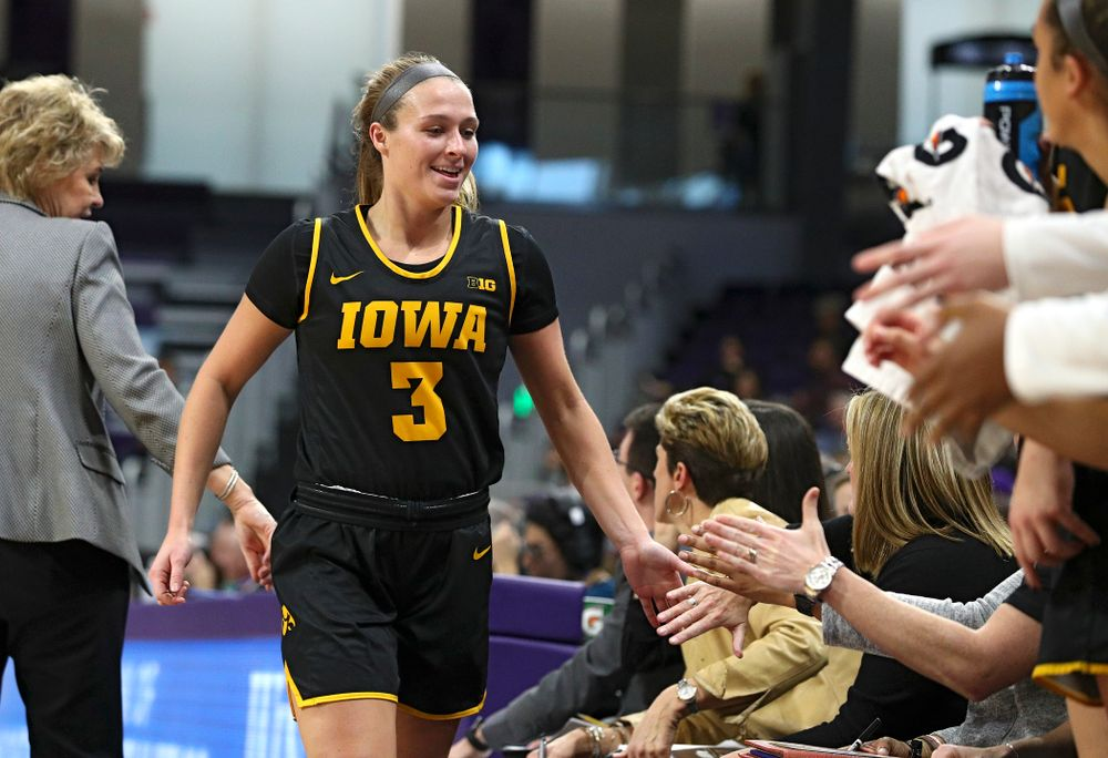 Iowa Hawkeyes guard Makenzie Meyer (3) smiles as she comes off the floor during the fourth quarter of their game at Welsh-Ryan Arena in Evanston, Ill. on Sunday, January 5, 2020. (Stephen Mally/hawkeyesports.com)