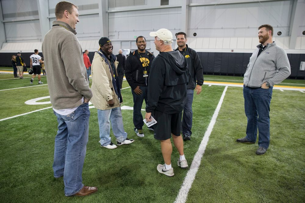 Iowa Hawkeyes defensive line coach Reese Morgan talks with members of the 2004 Big Ten Championship team following the team's walk through Friday, Sept. 12, 2014 in Iowa City.  (Brian Ray/hawkeyesports.com)