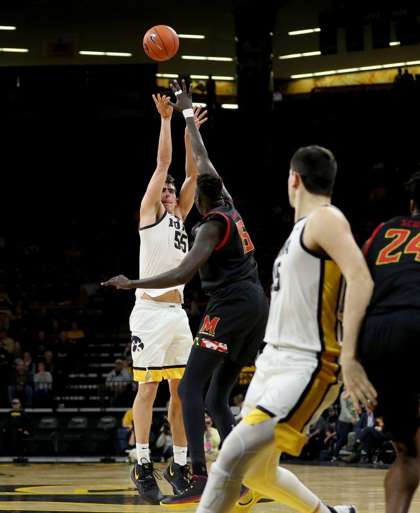 Iowa Hawkeyes forward Luka Garza (55) knocks down a three point basket against the Maryland Terrapins Friday, January 10, 2020 at Carver-Hawkeye Arena. (Brian Ray/hawkeyesports.com)