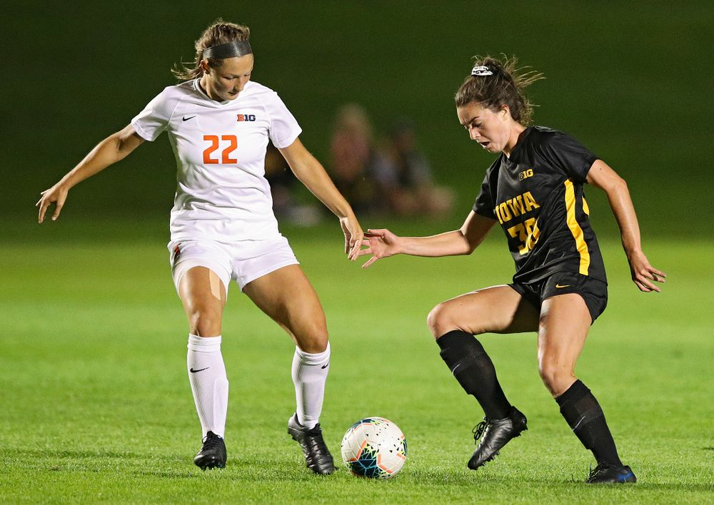 Iowa forward Devin Burns (30) battles for position on the ball during the first half of their match against Illinois at the Iowa Soccer Complex in Iowa City on Thursday, Sep 26, 2019. (Stephen Mally/hawkeyesports.com)