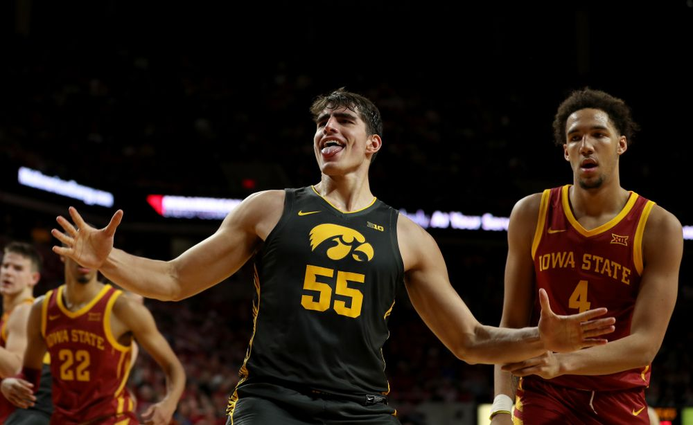 Iowa Hawkeyes forward Luka Garza (55) celebrates after dunking the ball against the Iowa State Cyclones Thursday, December 12, 2019 at Hilton Coliseum in Ames, Iowa(Brian Ray/hawkeyesports.com)