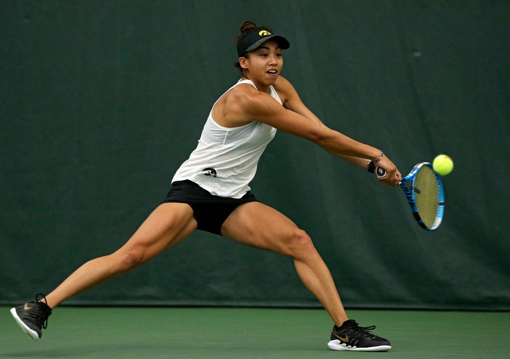 Iowa's Michelle Bacalla returns a shot during her singles match at the Hawkeye Tennis and Recreation Complex in Iowa City on Sunday, February 23, 2020. (Stephen Mally/hawkeyesports.com)