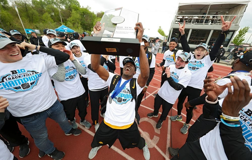 Iowa's Karayme Bartley holds up their team trophy as he celebrates with teammates after winning the Men's Big Ten Outdoor Track and Field Championships on the third day of the Big Ten Outdoor Track and Field Championships at Francis X. Cretzmeyer Track in Iowa City on Sunday, May. 12, 2019. (Stephen Mally/hawkeyesports.com)