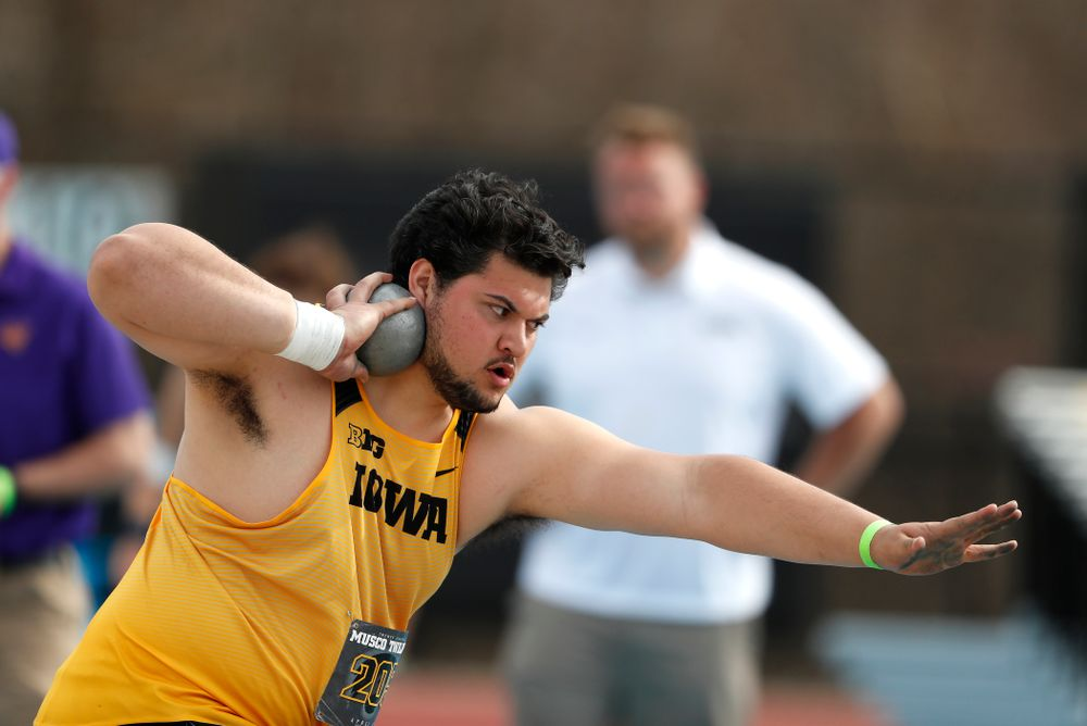Iowa's Iowa's Reno Tuufuli competes in the shot put during the 2018 MUSCO Twilight Invitational  Thursday, April 12, 2018 at the Cretzmeyer