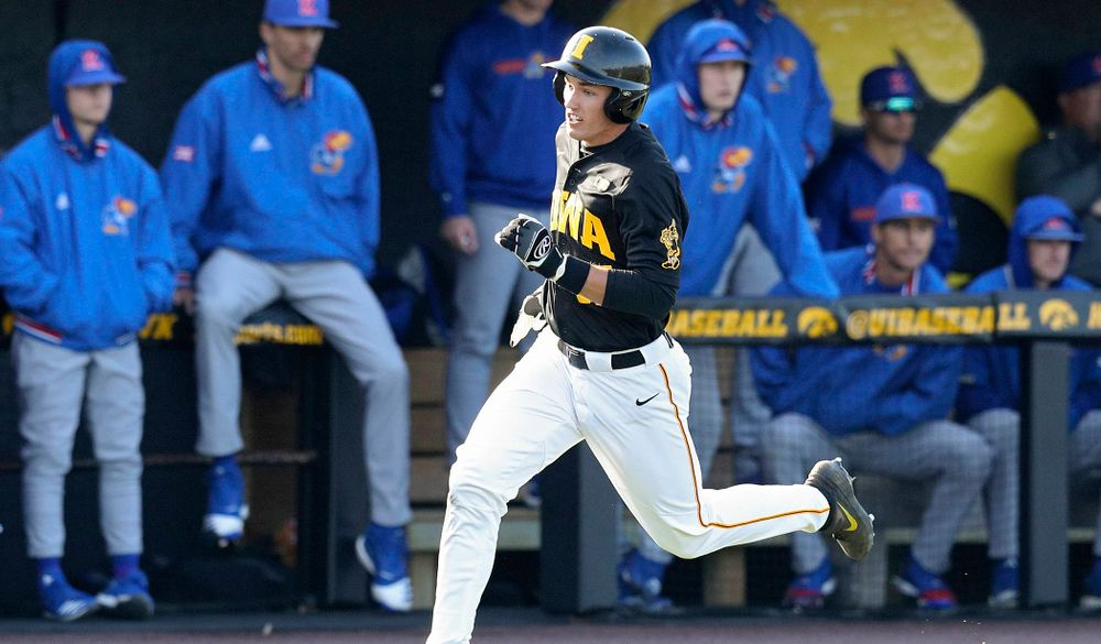 Iowa shortstop Dylan Nedved (17) runs home to score a run during the third inning of their college baseball game at Duane Banks Field in Iowa City on Tuesday, March 10, 2020. (Stephen Mally/hawkeyesports.com)