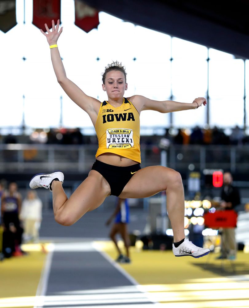 Gillian Urycki competes in the long jump