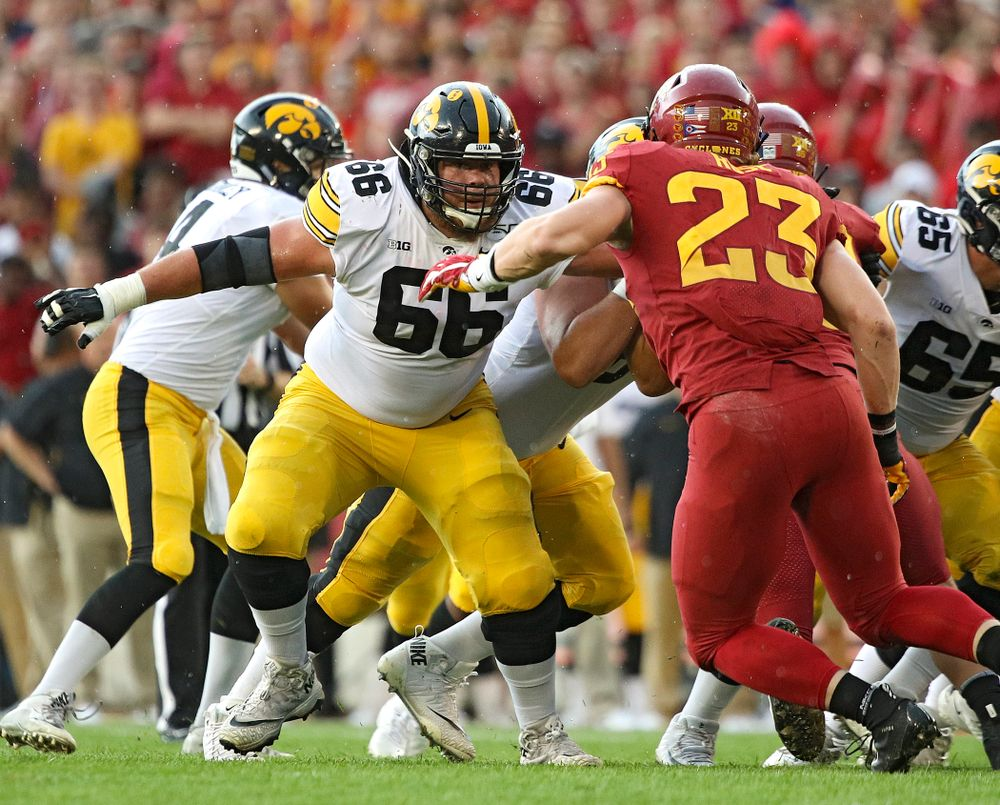 Iowa Hawkeyes offensive lineman Levi Paulsen (66) looks to block during the first quarter of their Iowa Corn Cy-Hawk Series game at Jack Trice Stadium in Ames on Saturday, Sep 14, 2019. (Stephen Mally/hawkeyesports.com)