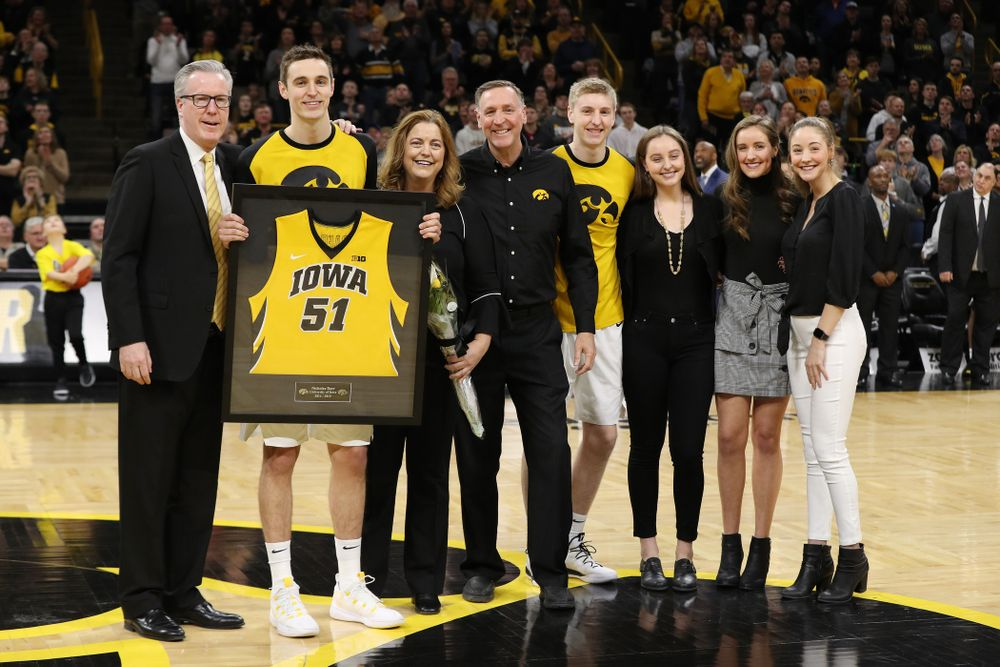 Iowa Hawkeyes forward Nicholas Baer (51) stands with head coach Fran McCaffery and his family during senior day actives before their game against the Rutgers Scarlet Knights  Saturday, March 2, 2019 at Carver-Hawkeye Arena. (Brian Ray/hawkeyesports.com)