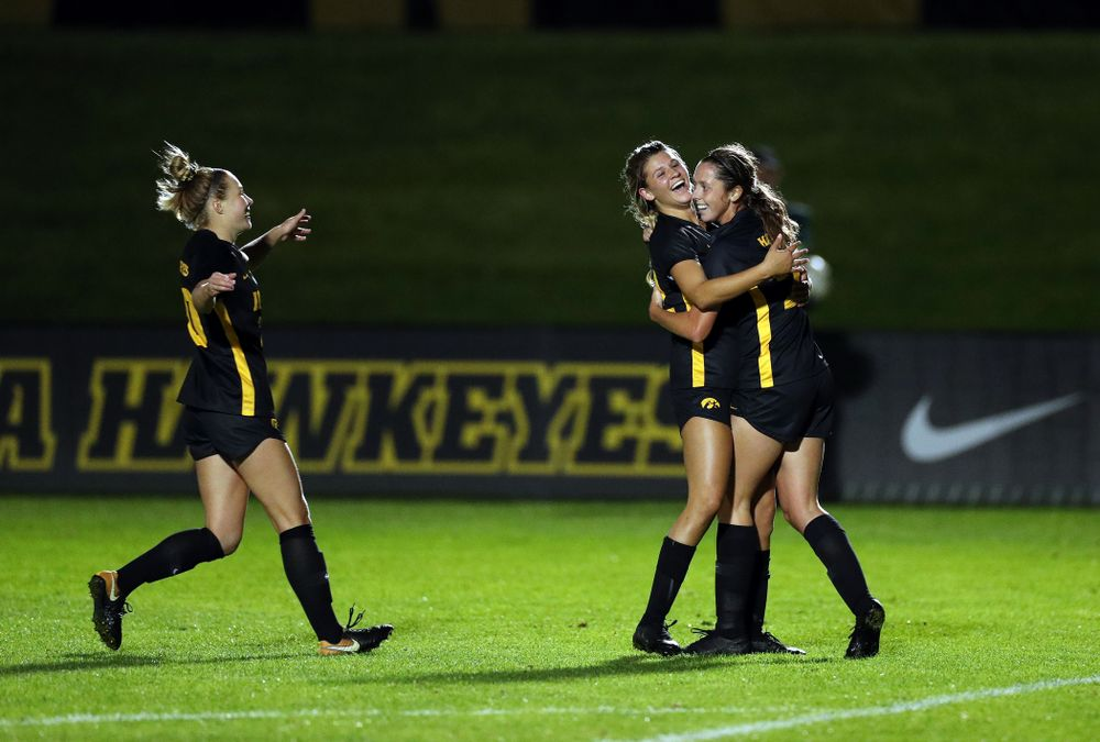 Iowa Hawkeyes forward Gianna Gourley (32) celebrates with midfielder Josie Durr (25) after scoring against the Nebraska Cornhuskers Thursday, October 3, 2019 at the Iowa Soccer Complex. (Brian Ray/hawkeyesports.com)