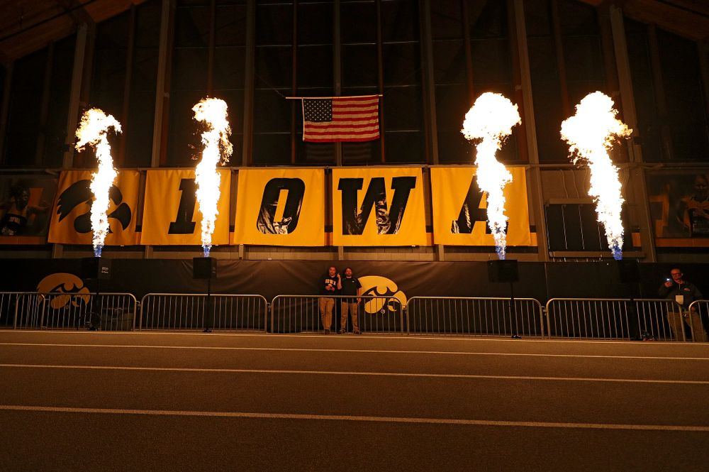 Pyrotechnics are used as the teams are introduced for the women's 1600 meter relay premier event during the Larry Wieczorek Invitational at the Recreation Building in Iowa City on Saturday, January 18, 2020. (Stephen Mally/hawkeyesports.com)