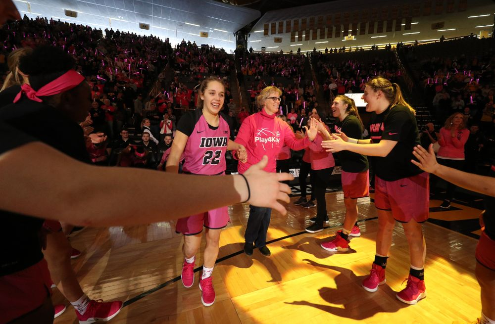 Iowa Hawkeyes guard Kathleen Doyle (22) is introduced with a cancer survivor before their game against the seventh ranked Maryland Terrapins Sunday, February 17, 2019 at Carver-Hawkeye Arena. (Brian Ray/hawkeyesports.com)