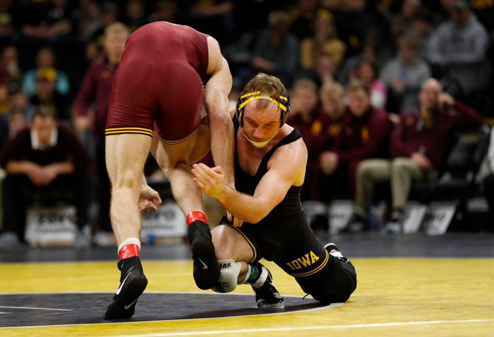 Iowa's Alex Marinelli wrestles Minnesota's Nick Wanzek at 165 pounds