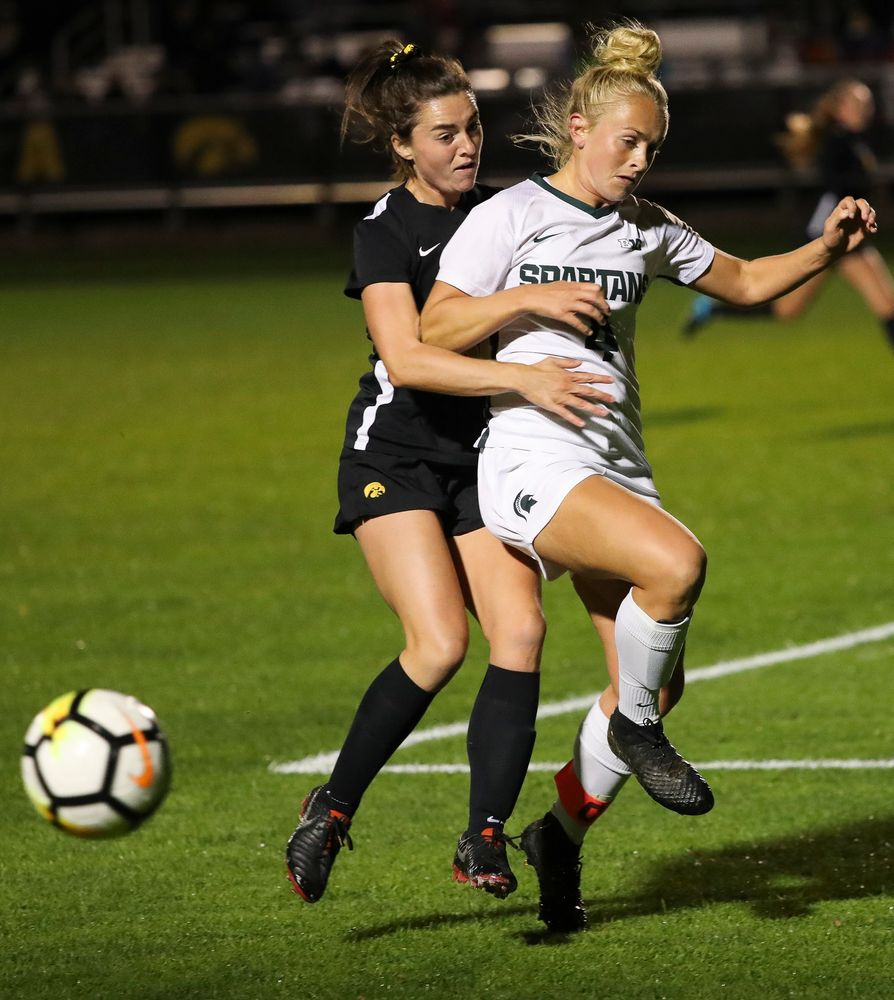 Iowa Hawkeyes forward Devin Burns (30) fights for possession during a game against Michigan State at the Iowa Soccer Complex on October 12, 2018. (Tork Mason/hawkeyesports.com)