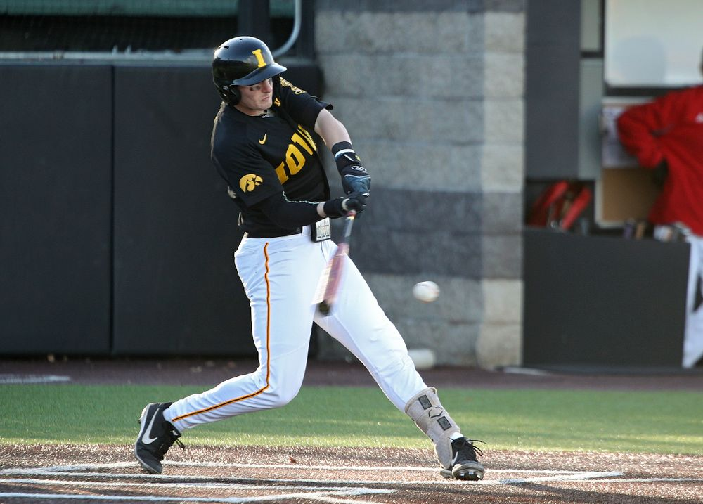 Iowa infielder Brendan Sher (2) drives a pitch during the second inning of their game at Duane Banks Field in Iowa City on Tuesday, March 3, 2020. (Stephen Mally/hawkeyesports.com)