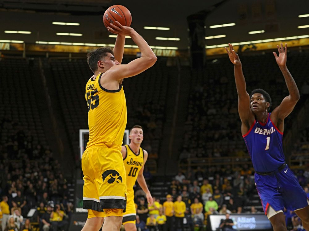 Iowa Hawkeyes center Luka Garza (55) makes a basket during the second half of their game at Carver-Hawkeye Arena in Iowa City on Monday, Nov 11, 2019. (Stephen Mally/hawkeyesports.com)