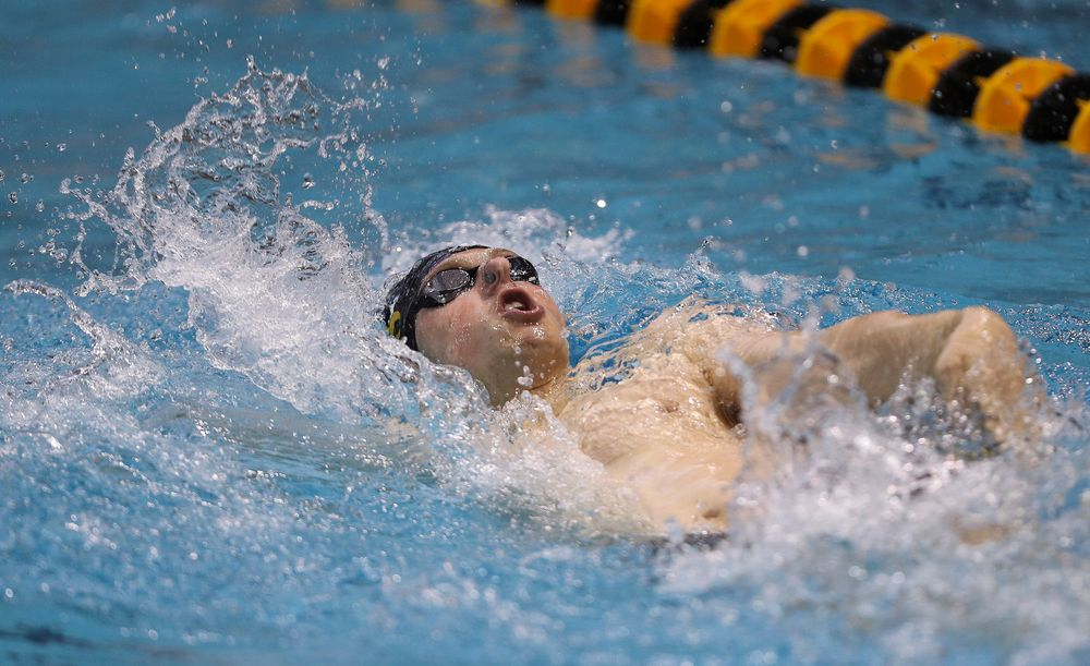 Iowa's John Colin competes in the 200-yard backstroke during the third day of the Hawkeye Invitational at the Campus Recreation and Wellness Center on November 17, 2018. (Tork Mason/hawkeyesports.com)