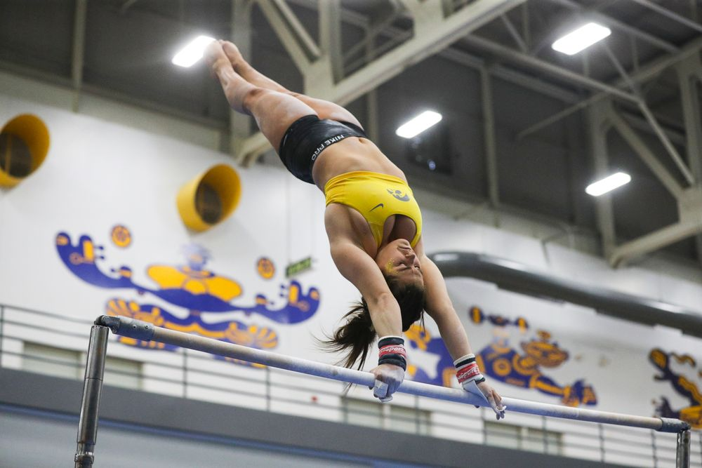 Erin Castle performs on the uneven bars during the Iowa women's gymnastics Black and Gold Intraquad Meet on Saturday, December 7, 2019 at the UI Field House. (Lily Smith/hawkeyesports.com)