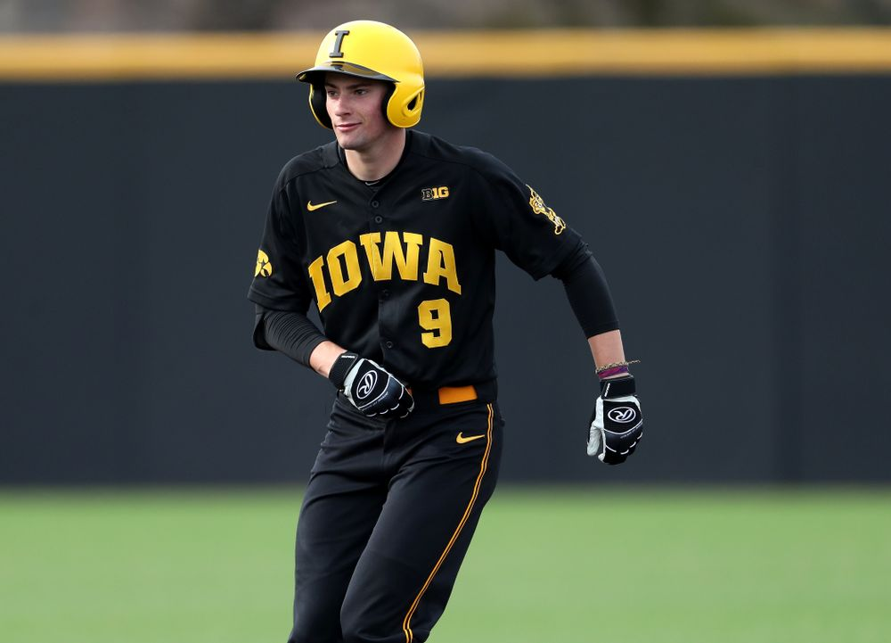Iowa Hawkeyes outfielder Ben Norman (9) doubles against Simpson College Tuesday, March 19, 2019 at Duane Banks Field. (Brian Ray/hawkeyesports.com)