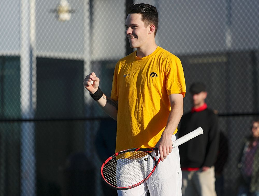 Iowa's Jonas Larsen pumps his fist as he celebrates a point during their doubles match again Michigan State at the Hawkeye Tennis and Recreation Complex in Iowa City on Friday, Apr. 19, 2019. (Stephen Mally/hawkeyesports.com)