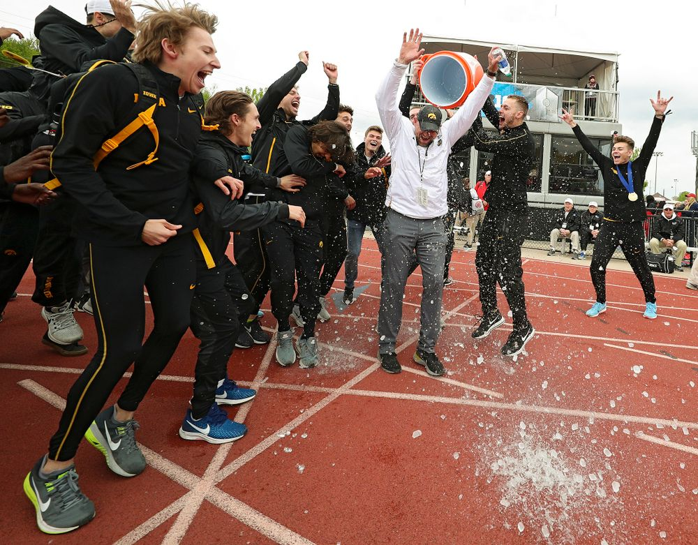 Iowa Director of Track and Field Joey Woody gets a Gatorade shower after winning the Men's Big Ten Outdoor Track and Field Championships on the third day of the Big Ten Outdoor Track and Field Championships at Francis X. Cretzmeyer Track in Iowa City on Sunday, May. 12, 2019. (Stephen Mally/hawkeyesports.com)