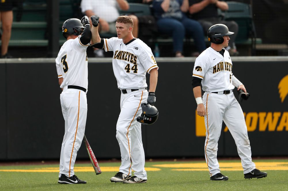 Iowa Hawkeyes outfielder Robert Neustrom (44) celebrates with infielder Matt Hoeg (3) after hitting a home run against the Missouri Tigers Tuesday, May 1, 2018 at Duane Banks Field. (Brian Ray/hawkeyesports.com)