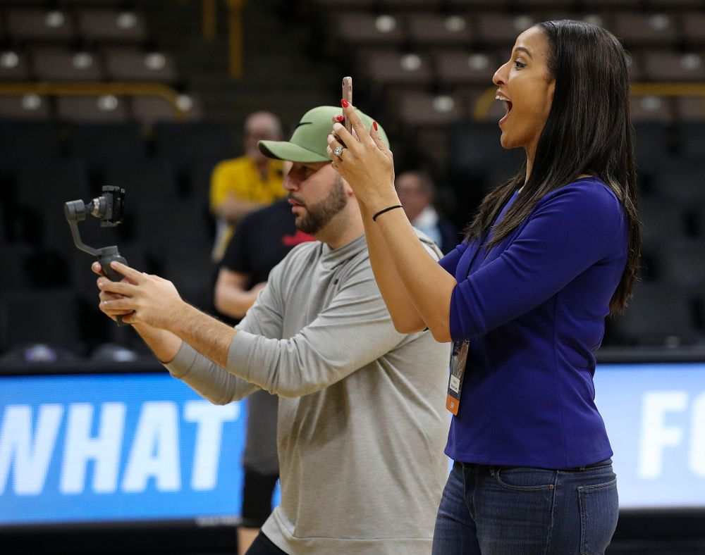 Christy Winters Scott, analyst for ESPN, watches in amazement as Iowa Hawkeyes forward Megan Gustafson (not picture) runs a drill at a practice during the 2019 NCAA Women's Basketball Tournament at Carver Hawkeye Arena in Iowa City on Saturday, Mar. 23, 2019. (Stephen Mally for hawkeyesports.com)