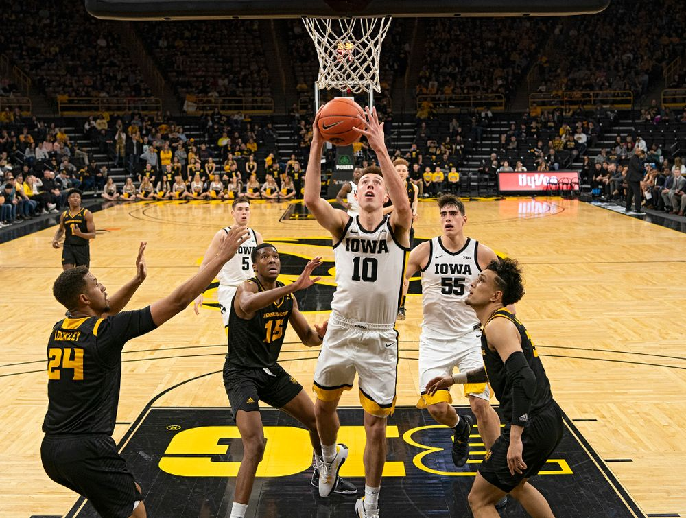Iowa Hawkeyes guard Joe Wieskamp (10) drives in and scores during the second half of their their game at Carver-Hawkeye Arena in Iowa City on Sunday, December 29, 2019. (Stephen Mally/hawkeyesports.com)