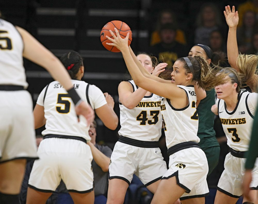 Iowa Hawkeyes guard Gabbie Marshall (24) pulls down a rebound during the second quarter of their game at Carver-Hawkeye Arena in Iowa City on Sunday, January 26, 2020. (Stephen Mally/hawkeyesports.com)