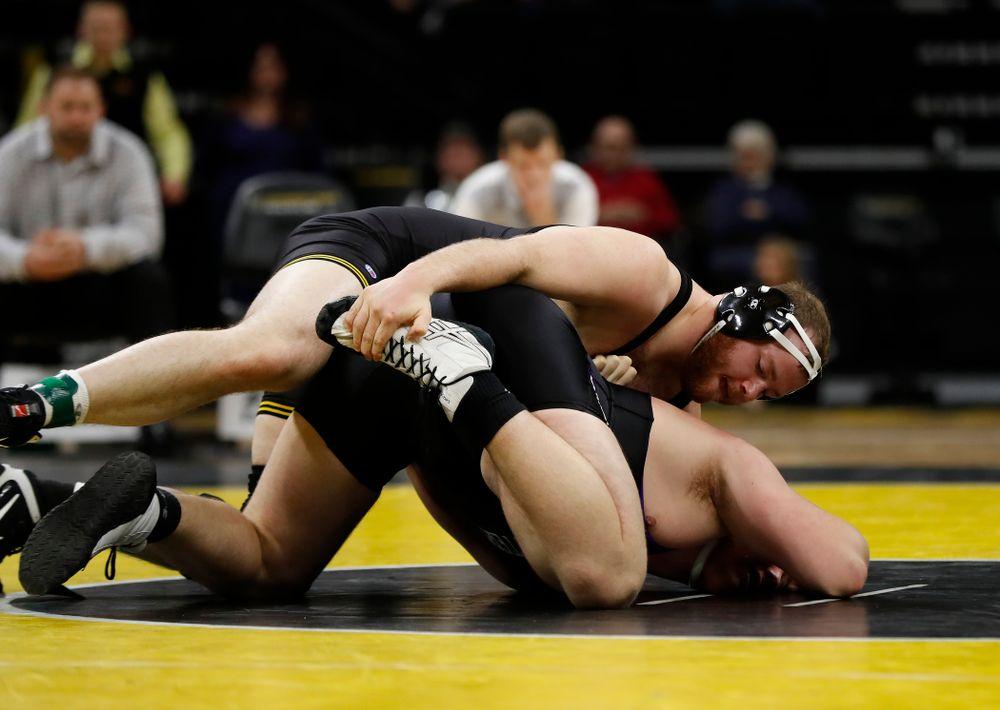 Iowa's Sam Stoll wrestles Northwestern's Conan Jennings at heavyweight