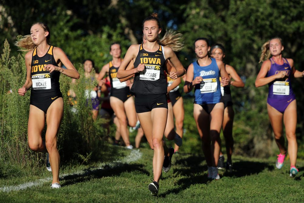 IowaÕs Jessica McKee and Grace McCabe runs in the 2019 Hawkeye Invitational Friday, September 6, 2019 at the Ashton Cross Country Course. (Brian Ray/hawkeyesports.com)
