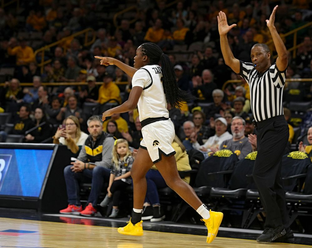 Iowa Hawkeyes guard Tomi Taiwo (1) points after making a 3-pointer during the first quarter of their game at Carver-Hawkeye Arena in Iowa City on Tuesday, December 31, 2019. (Stephen Mally/hawkeyesports.com)