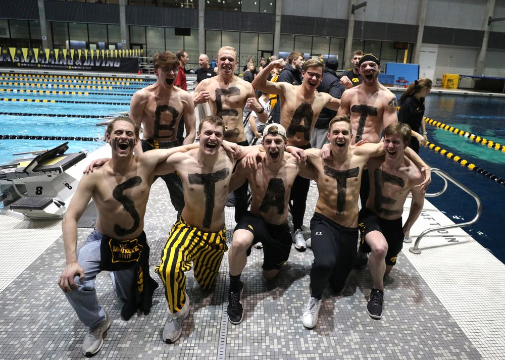 Members of the men's team cheer on the Iowa Hawkeyes women's team against the Iowa State Cyclones in the Iowa Corn Cy-Hawk Series Friday, December 7, 2018 at at the Campus Recreation and Wellness Center. (Brian Ray/hawkeyesports.com)
