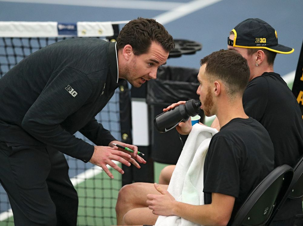 Mellecker Family Head Men's Tennis Coach Ross Wilson )(from left) talks with Kareem Allaf and Nikita Snezhko during their doubles match at the Hawkeye Tennis and Recreation Complex in Iowa City on Friday, March 6, 2020. (Stephen Mally/hawkeyesports.com)