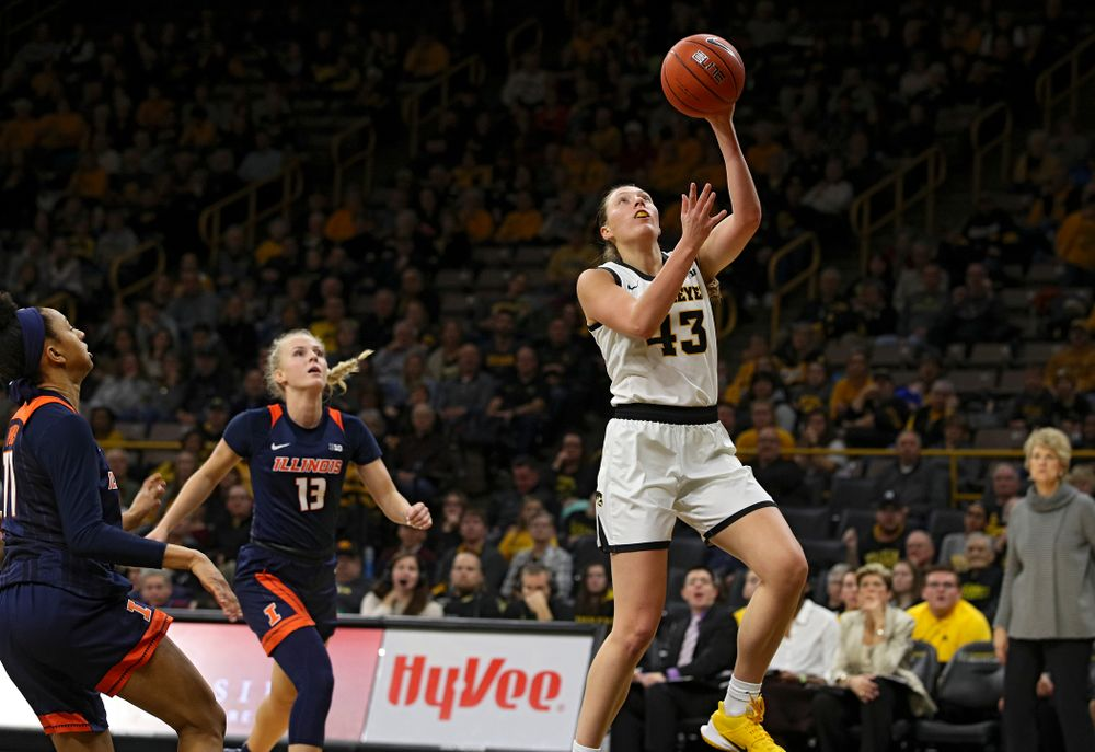 Iowa Hawkeyes forward Amanda Ollinger (43) scores a basket during the fourth quarter of their game at Carver-Hawkeye Arena in Iowa City on Tuesday, December 31, 2019. (Stephen Mally/hawkeyesports.com)